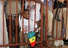"""Birthers Swarm Obama In Africa, """"Welcome Home, Mr. President""""… Via TPM: During a visit to Goree Island, Senegal on Thursday, President Barack Obama crossed a rope line and mingled with a crowd of people who had gathered. The crowd included several children who, according to a White House pool report, were donning white t-shirts with the caption: """"Welcome home, Mr. President."""" [06/27/13]"""