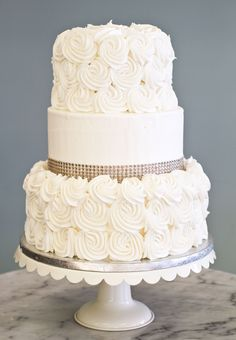 A simple, elegant wedding cake with rosettes and rhinestones.