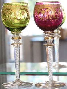 Pair of vintage richly decorated and gilt tall Bohemian glass wine goblets