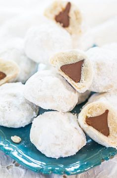 Chocolate Kiss Surprise Powder Puff Cookies | These cookies look like Russian tea cakes or Mexican wedding cookies (or even snowballs), but they have a fun chocolate surprise in their center!