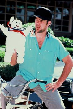 Rare and beautiful celebrity photos - Dan Akyroid with a Stay-Puff Marshmallow Man stuffed toy