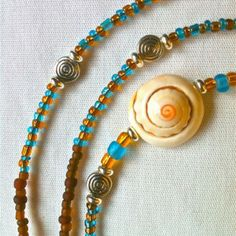#waistbeads #rootsnculture #keffigal Dreamcatcher: Single Strand: Brown, Honey, Blue seed beads with shell and metal accents.