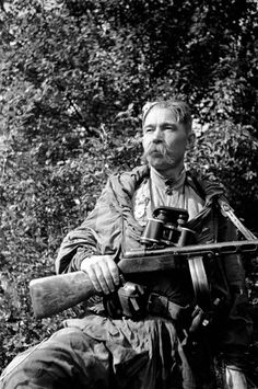 """Portrait of Soviet Guard Sgt. Alexey G. Frolchenko of the 325th """"Dvina"""" Infantry Division carrying his PPSh-41 submachine gun, 1943"""