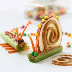 cute food.  snail celery apple snack