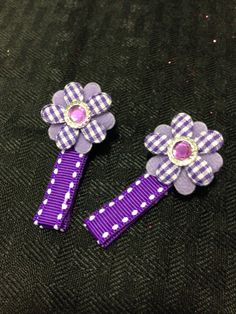 Purple ribbon alligator hair clip with flower and jewel center by GabbyAbbyCrafts on Etsy https://www.etsy.com/listing/261086199/purple-ribbon-alligator-hair-clip-with