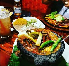 How about a Molcajete for lunch? Try it with Angus Steak, Grilled Chicken, Shrimp or all three! Tag your lunch buddy! #QuePasaCafe www.qpmexicancafe.com/locations.html