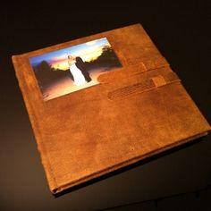 "Distressed leather cover of Koreana and Chris' 10x10"" leather Roma wedding album. #weddingalbum #scottsdaleweddingphotographer #davidorrphotography #customdesign #couturebook"