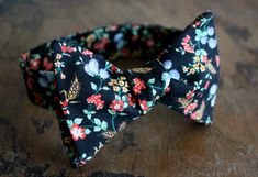 Gorgeous floral bow tie (colors: photo is quite accurate, navy blue background with little red, blue and gold flowers). Its perfect for a Navy Bow Tie, Floral Bow Tie, Gentleman, Navy Blue Background, Cool Ties, Men Street, Tie Colors, Suit And Tie, Wedding Suits