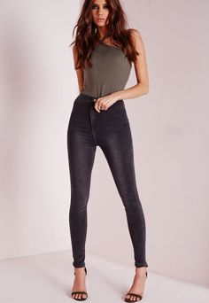 """Petite High Waisted Skinny Jeans Grey - """"good things come in small packages. shop our missguided petite range, for babes 5'3"""""""" and under. These charcoal grey high waisted beauts come in a super soft stretch finish, creating a flattering fit and sexy silhouette! Front zip and button fasten 70% Cotton 28% Polyester 2% Spandex Jaqui wears a UK size 8 / EU size 36 / US size 4"""""""