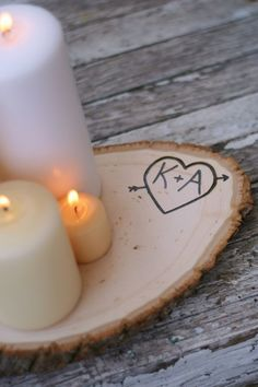 i love the idea of wood as the base for the centerpieces. love that the initials are carved into it too.@Alicia T T black