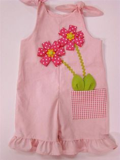 Inspiration for a knot romper...love the ribbon flowers and leaves coming out of the pocket