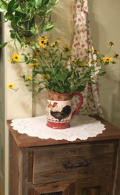 Lazy Susans from my wildflower garden in my favorite vase.  This farm cabinet was made by a friend from old barn wood