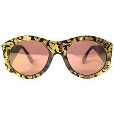 Preowned New Vintage Christian Lacroix Black & Gold Baroque 1980... (29.280 RUB) ❤ liked on Polyvore featuring accessories, eyewear, sunglasses, black, gold glasses, christian lacroix sunglasses, christian lacroix glasses, mirrored lens sunglasses and vintage glasses