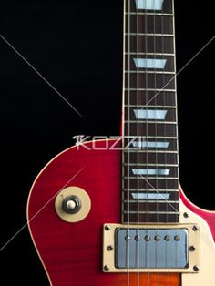 cropped image of electric guitar. - Close-up cropped shot of strings of electric guitar over dark background.