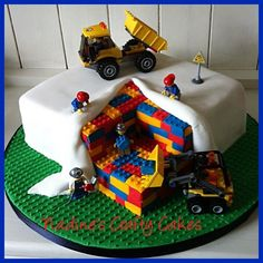 "This cake was good fun to ""build"". I made it for my friends son and the Lego toys are a little extra present for the birthday boy. :-)"