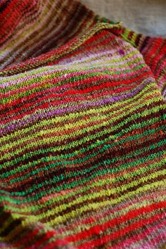 I'm getting there! Noro Taiyo yarn, 2 row stripes from each of two balls of the same colorway. Sweater made from 4 rectangles- no shaping. Boat neck, rolled hems.
