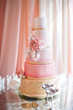 Gorgeous pink and gold ombre tiered wedding cake.