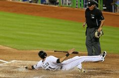 MIAMI, FL - SEPTEMBER 27: Christian Yelich #21 of the Miami Marlins scores on a double by Giancarlo Stanton #27 (not pictured) during a game against the Detroit Tigers at Marlins Park on September 27, 2013 in Miami, Florida.