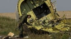 A pro-Russian rebel touches the wreckage at the crash site of Malaysia Airlines Flight near the village of Hrabove, eastern Ukraine, Tuesday, July Malaysia Airlines Flight 17, Liberation Theology, World Problems, News Channels, Documentary Photography, Show Photos, Social Issues, Old World, Ukraine