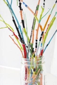 Make a painted twig bouquet with your kids for an easy and colorful centerpiece!