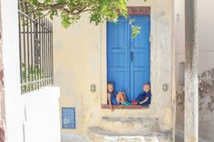 how to take a year off with kids how they did it traveling to greece little girls in doorway