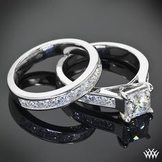 Quite an amazing duo, this Custom Channel Set Diamond Wedding Set is cast in platinum. The 4 prong Engagement Ring holds 0.40ctw Princess Cut Diamond Melee and has a trellis style design.