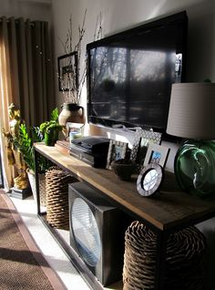 TV console with woven stools below for extra seating. Multi-tasking furniture for a small living room. New Living Room, Home And Living, Living Room Decor, Tv Stand Decor, Sweet Home, Living Room Designs, Tv Stand Ideas For Living Room, Family Room, New Homes