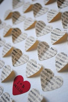 "Personalized ""love song"" gift.  choose your favorite song, and it will be cut out in tiny hearts."