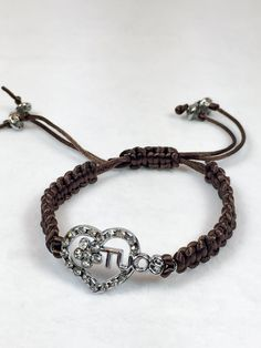 This beautiful bracelet is made using a macrame techniques and in the center a silver heart. This bracelet is adjustable and is closed with a sliding knot. Measure 7 inches