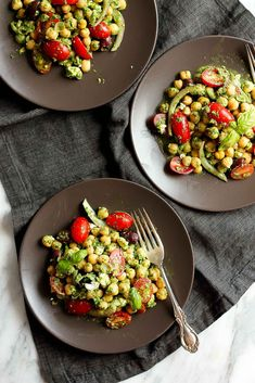 Looking for a healthy lunch option that's easy to make and uber satisfying? Try this beautiful chickpea pesto salad full of mediterranean flavors. Also wonderful for parties and picnics!