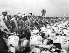 Vintage black and white photo of an entire fleet of Vespas for the 1960 Rome Olympics.  Look at all of those scooters!
