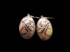 Frog Earrings,  easuring 1.25 x  0.75. Made of Sterling Silver. By Ojibway artist Joe Descoteaux. Northwest Coast First Nations Jewelry.