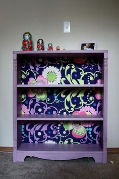8 great DIY bookcases. Paint an old dresser and add fabric behind the shelves for an awesome bookcase!
