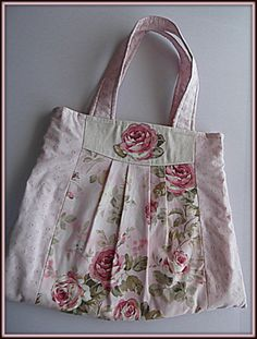 Shabby chic purse or diaper bag in beautiful rose pattern with an appliqued rose on the front of the bag.