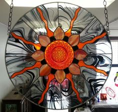 """Sun-Universe - Artist Bob Bursey (Corydon, IN) designed and crafted this beautiful 30 1/4"""" diameter """"Sun-Universe"""". From the center of the universe/ antique plate, the sun rays reach out & bless everyone who sees it."""
