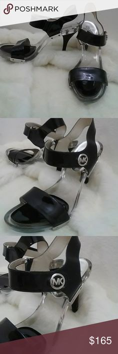 """SHOES MICHAEL KORS Beautiful black Michael Kors with Lucite high heels. Velcro strap, wraps around your ankle. Silver Michael Kors hardware. Approximately 3"""" in heel height. No scuffs. I wore these shoes 2 times. They are in excellent condition. You will get a lot of compliments on these size 8M. Michael Kors Shoes Heels"""