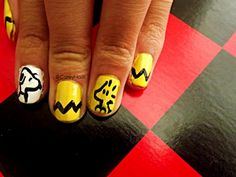 These cute Snoopy themed painted nails are truly the cutest! If you have time, and adore Snoopy and his friends, other Charlie Brown characters like Woodstock, be sure to create something like this...