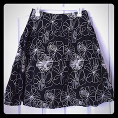 "Chico's Black Knee Length Floral Skirt - Size 0 This beautiful & classy black skirt with appliqué of cream colored flowers is in perfect condition! Fully lined and 100% cotton. The length of the skirt measures 23 1/2"". It fits like a size S or 4. Chico's Skirts A-Line or Full"
