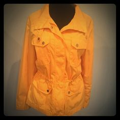 Beautiful Yellow Rain Jacket Beat the winter blues with a gorgeous and vibrant yellow rain jacket. Every time I wear this jacket, women walk across a room to ask me where I bought it from. I don't want to part with it, but it's too big now!!!!!  By the way, this jacket is lined and the cinching located inside the jacket is adjustable. Coldwater Creek Jackets & Coats