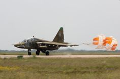 "Ukrainian Air Force Sukhoi Su-24 'Frogfoot"" attack aircraft landing with brake chute deployed."