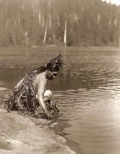You are viewing a rare image of a Whale Ceremonial - Clayoquot. It was taken in 1910 by Edward S. Curtis.    The image shows Nootka indian taking ceremonial bath, before whale hunt.    We have created this collection of images primarily to serve as an easy to access educational tool. Contact curator@old-picture.com.