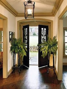 Beautiful antique French doors opening into a simply decorated foyer Small Front Entryways, Small Foyers, Small Hallways, Hallway Ceiling Lights, Foyer Lighting, Lighting Ideas, Lighting Design, Front Door Entryway, Entry Hallway