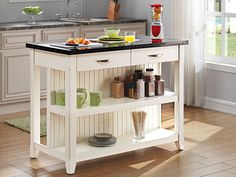 We love this cottage-style island: This nimble 2-by-4-foot helpmate, aptly called the Server, has beadboard paneling and a black granite top. One side has two open shelves and drawers, and the other can squeeze in two barstools. From @twinstarintl