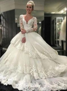 I found some amazing stuff, open it to learn more! Don't wait:http://m.dhgate.com/product/vintage-v-neck-tiered-long-sleeves-ball-gown/391797396.html