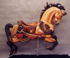 Military horse jumper painted by Tim Racer, carved by Ed Neinaber.