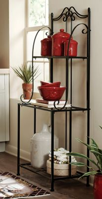 Handy baker's rack sits pretty in your kitchen and adds extra storage. All black with scroll work design along the sides and top.
