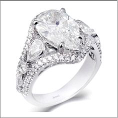 Simon G  This beautiful pear-shaped diamond is not alone! It comes with lots of other diamonds including 2 side pear-shaped ones.