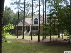 BRING THE IN LAWS TO THIS HOME. 2 MASTER SUITES 2 LAUNDRY AREAS. HEAVILY WOODED ACRES IN GATED COMMUNITY
