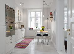 clean and simple kitchen. white painted hardwood floors.  Kök | Alvhem Mäkleri