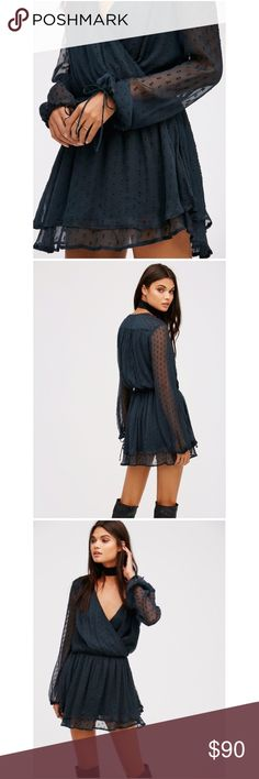 """Free People Deep Jade Mini Dress A romantic Free People mini dress with a deep surplice neckline and ruched shoulders. Layered ruffles at the flared skirt. Drawstring cuffs and sheer long sleeves. Fabric: Crinkled gauze. 100% rayon. Bust 29 1/2"""", waist 30"""", length 34"""", sleeve length 25"""". Hand wash. No trades. Reasonable offers welcome. Free People Dresses Mini"""